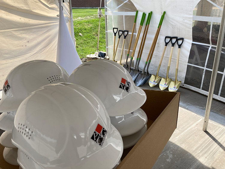 Safety helmets and ceremonial shovels